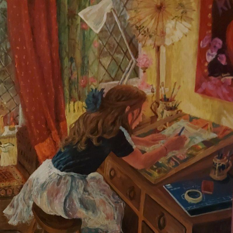 Girl drawing at art desk