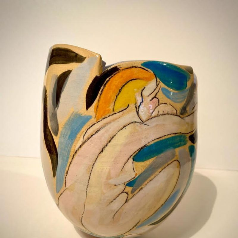 multi-coloured pot organic shape with nude woman illustrated through application of slipware