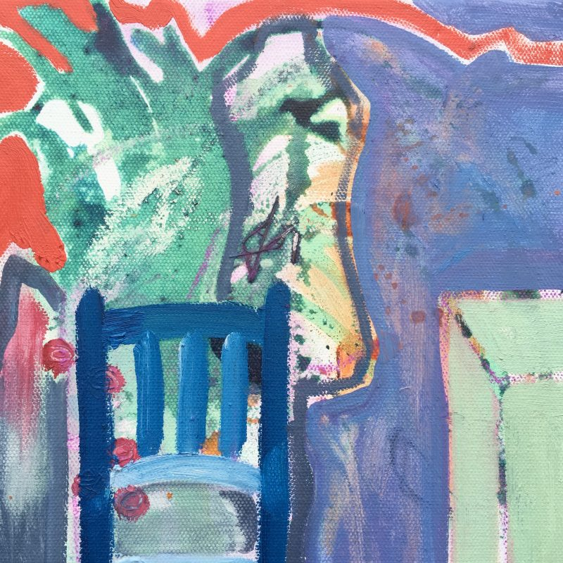 In foreground stands a blue chair. Behind are aspects of the studio in greens, oranges and blues. It feels vibrant and alive.