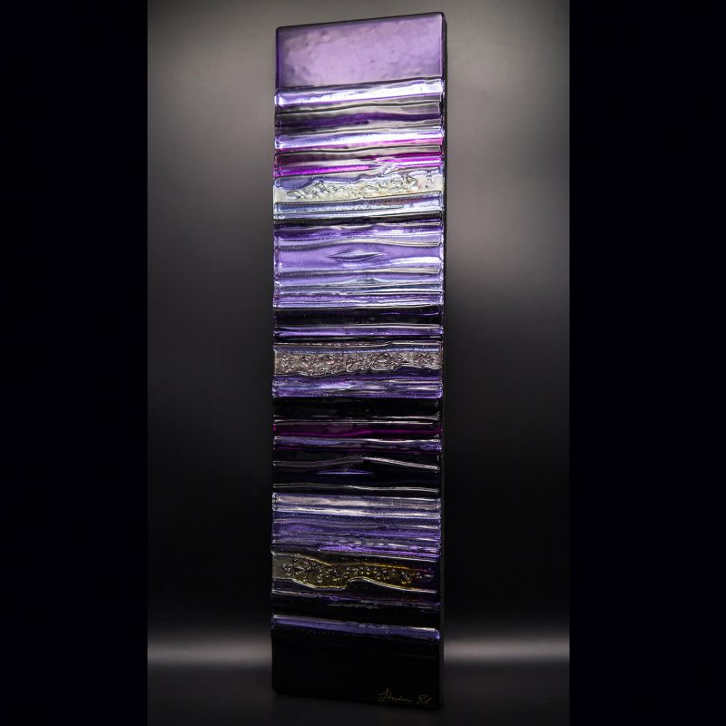 A stunning sculpted glass wall panel in shades of violet and purple.