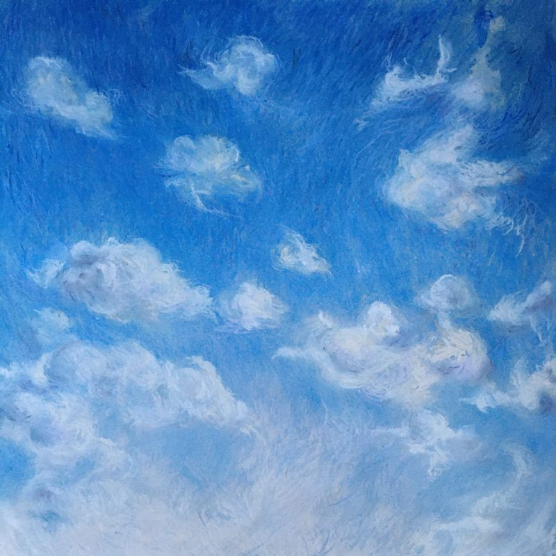 Light clouds floating high in blue sky over shining sea