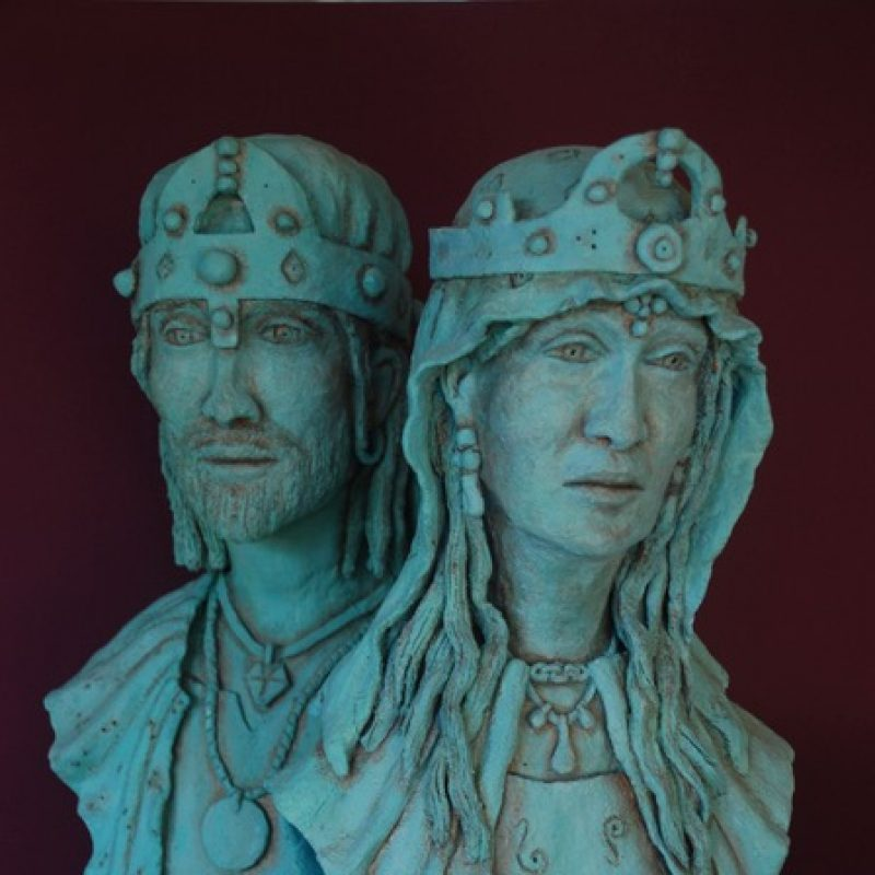 Pair of verdigris sculptures of a medieval King and Queen.