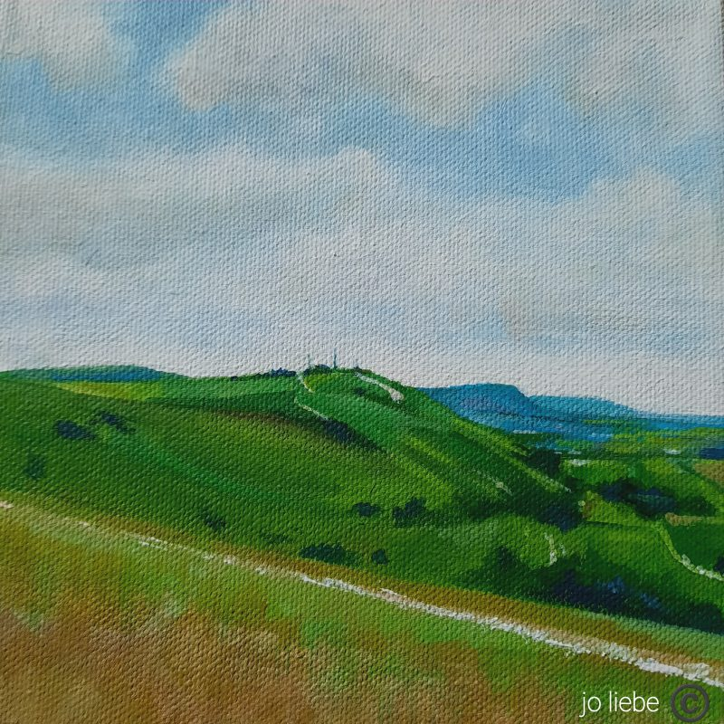 Blue skies, few clouds, rolling Downs and a chalk path capture the essence of the Downs