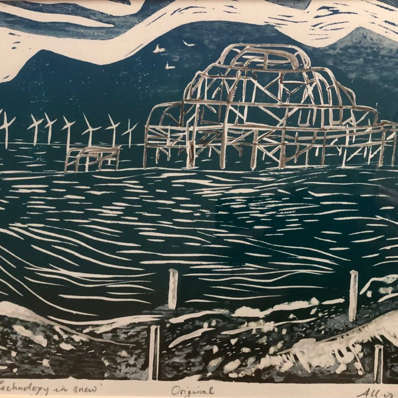 A wood relief. The image was carved into wood and then printed with rolled blended inks. This image is a one off as the artist has added snow. The image is of Brighton's West Pier. Three birds of hope fly over  the pier and lead you to see the wind farm on the horizon. The colours are blues, whites, greys and browns for the pebbled  beach. Waves roll in on the beach representing time continues.