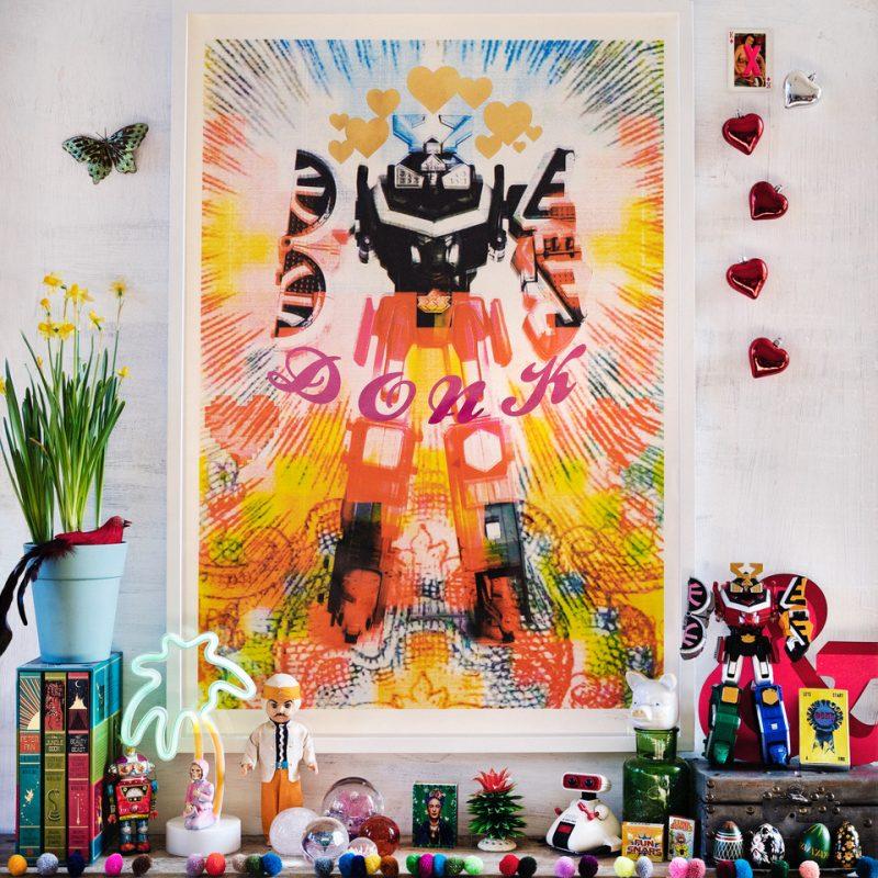 Framed colourful Robot screenprint, on a shelf