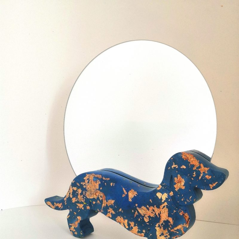 A navy and copper chunky 3d standing dachshund with circular mirror