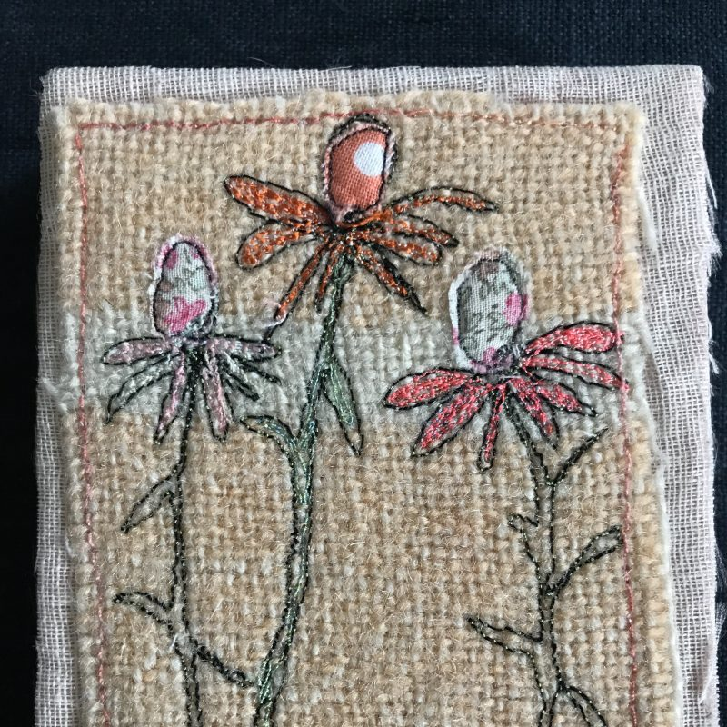 Flowers embroidered on hessian