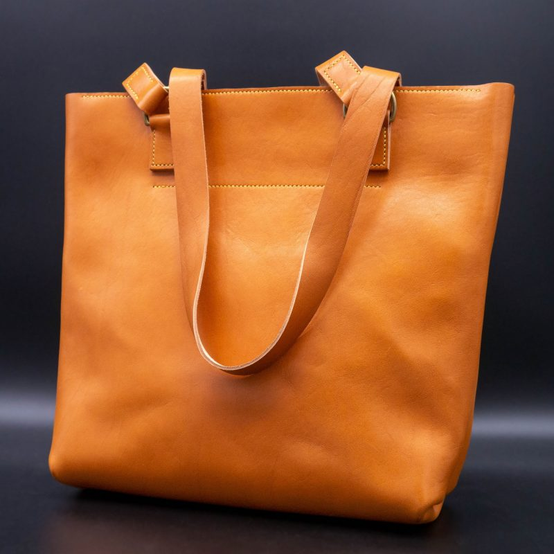 A beautiful hand made, leather tote bag in autumn orange.