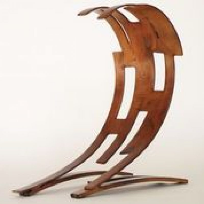 a steel abstract sculpture of a wave form with a coppery patinated finish