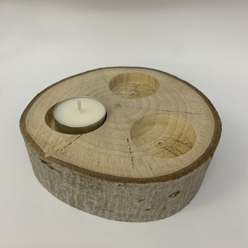 Wooden tealight holder (holds three tealight candles) made from a cross section of a tree trunk.