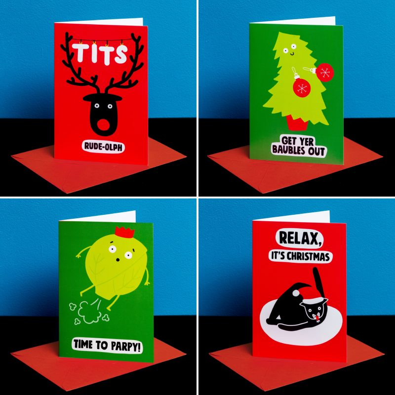 A photo showing four funny Christmas cards