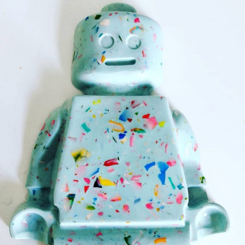 large 3d lego man plaque with multi coloured terrazzo chips.