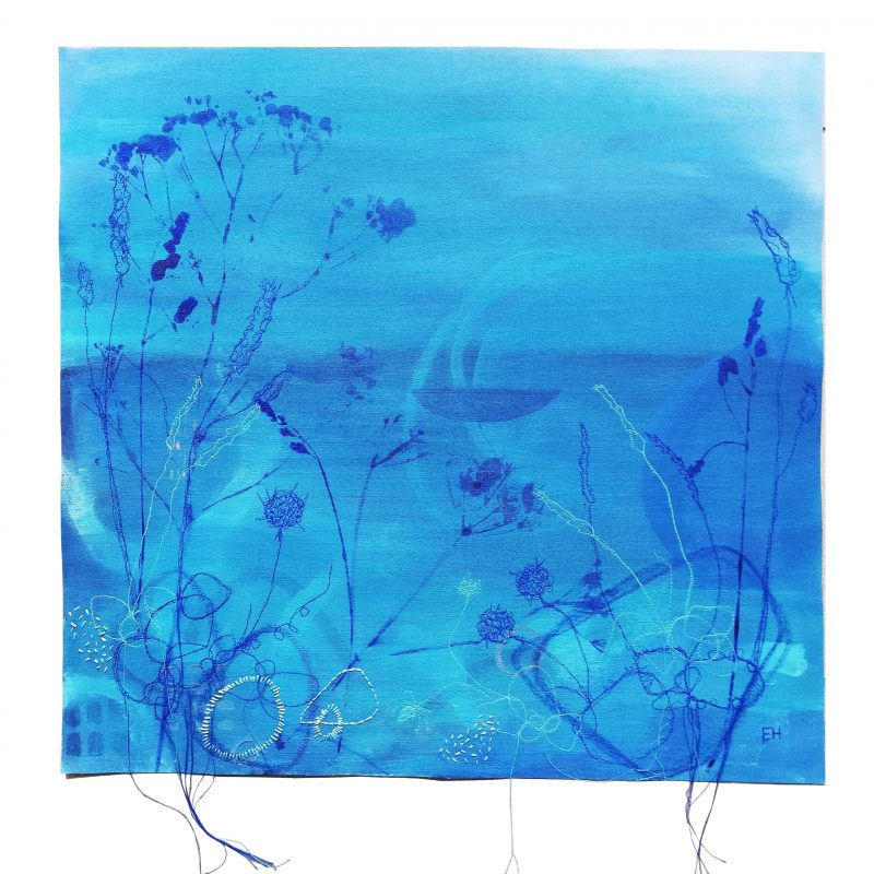 a blue painting with textile