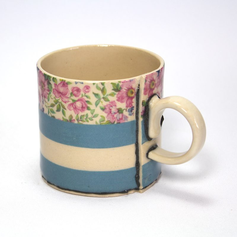 Blue and white stripey cup with floral motifs