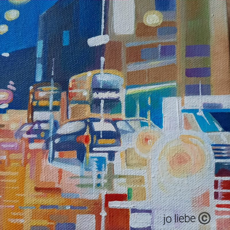 Busy traffic scene in blues, bright colours capturing the lights on a rainy day.