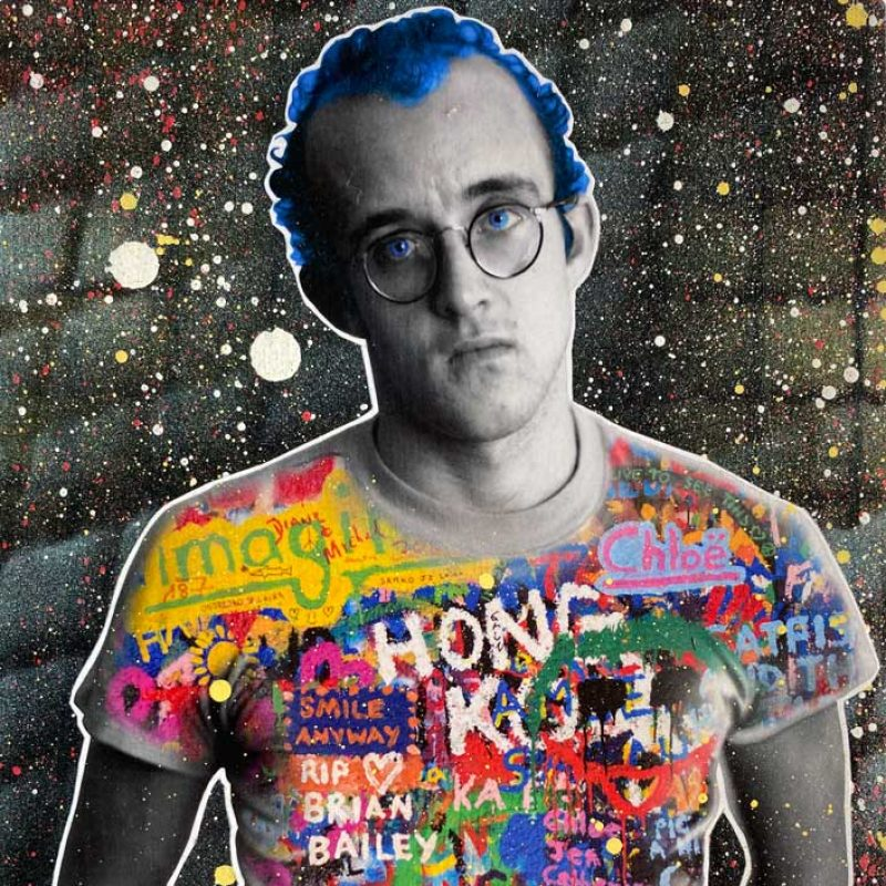 An image of Keith Haring, with graffiti on his t shirt with a dark background