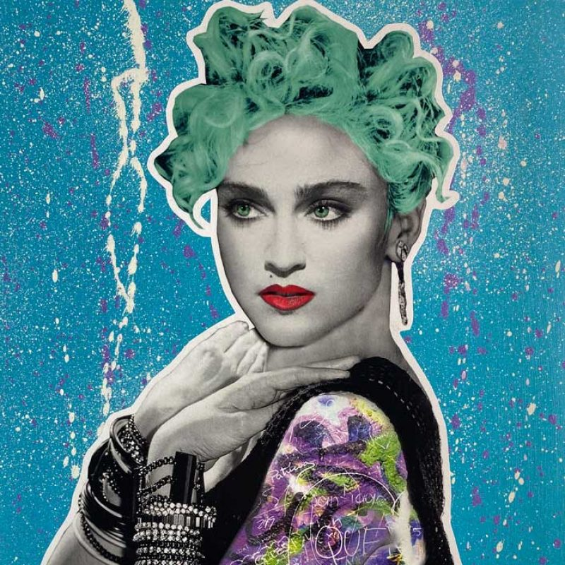 Image of Madonna the pop icon with green hair and a graffiti 'tattoo' on her arm.