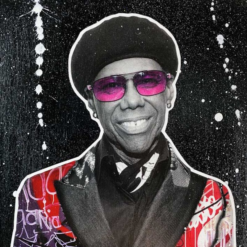 A stylized image of Nile Rogers  with red shades and a multicoloured jacket