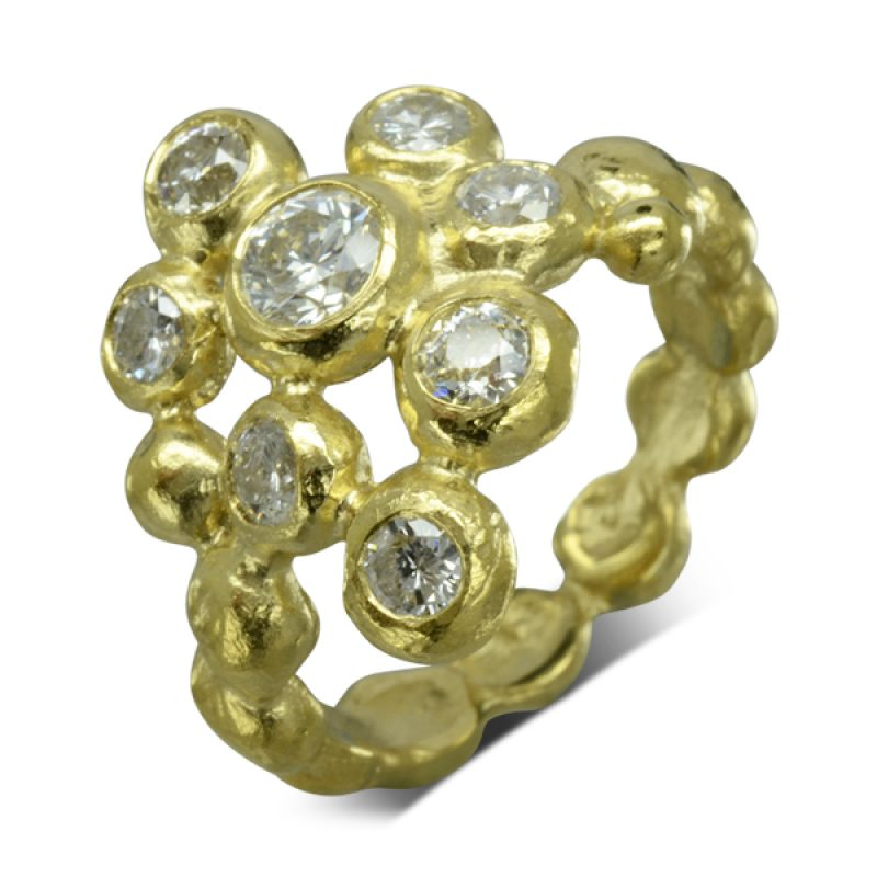 yellow gold nuggets loosely assembled set with diamonds