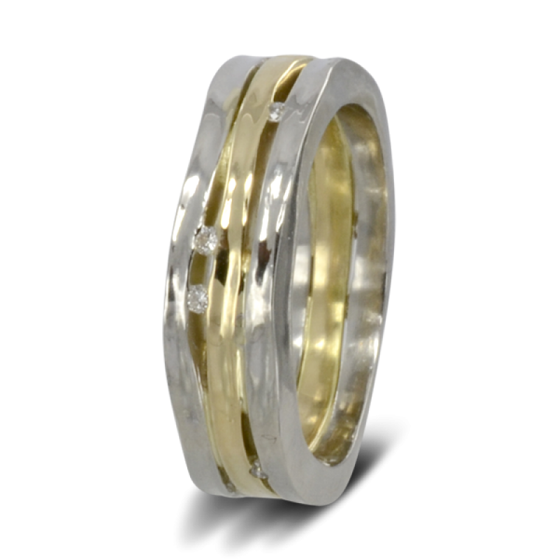 two hammered platinum bands either side of a hammered 18ct yellow gold band with diamonds trapped in the gaps between them