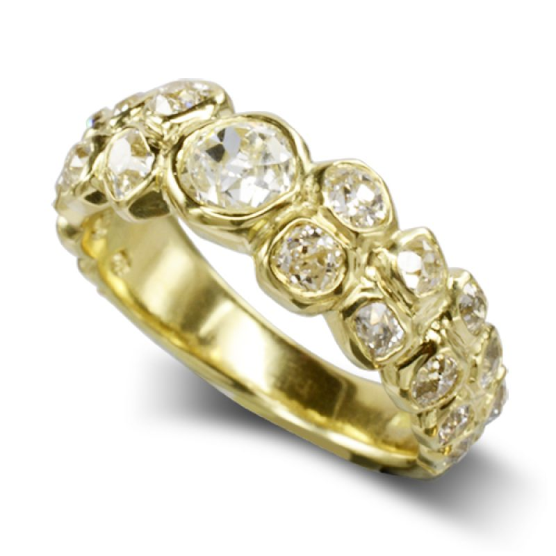 old cut diamonds set in irregular carved 18ct yellow gold around a ring