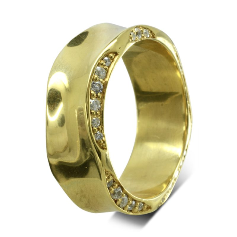 a side hammered wide 18ct yellow gold ring with pave set diamonds on the sides