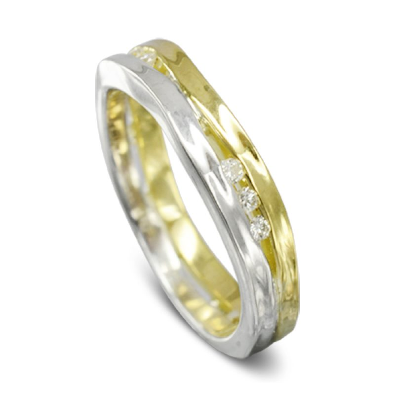 A slim hammered band of platinum with a slim hammered band of gold with diamonds interspersed at intervals trapped between them