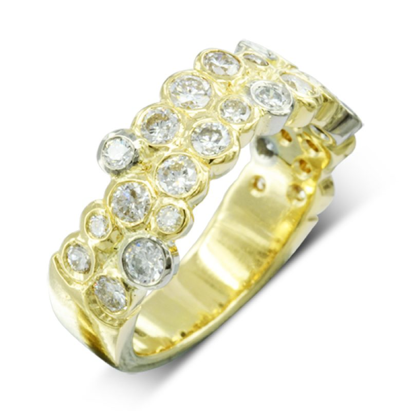 diamonds in round platinum and yellow gold settings in a bubbles foam formation randomly around the ring
