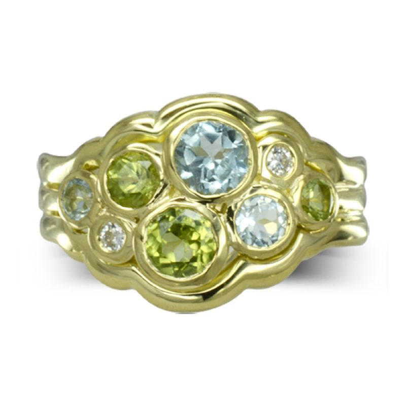 sea blue aquamarines, lime green peridots, diamonds set in a bubbles pattern in 18ct yellow gold