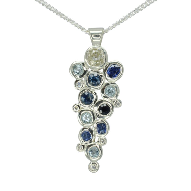 sapphires and old cut diamonds in rough round platinum settings soldered together in a bubbles foam pattern on an 18 inch curb chain