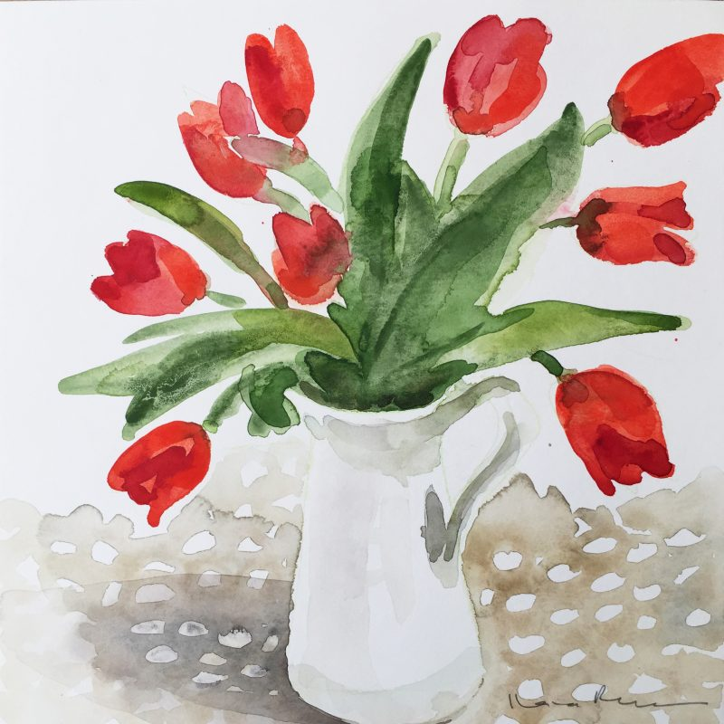 Red tulips in a White Jug