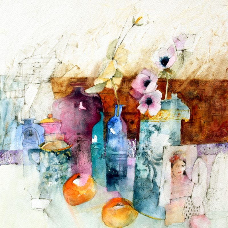 Vase with flowers and a picture