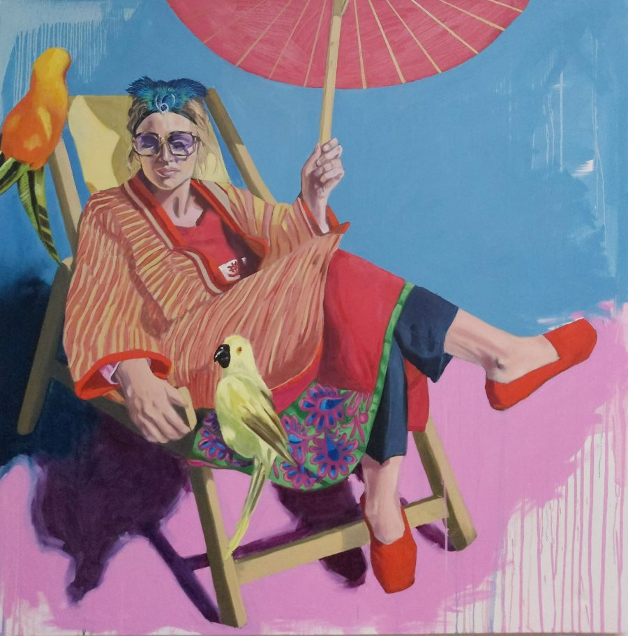 This is a painting of a lady sitting on a deckchair in the sunshine holding an umbrella . The colours are very bright and there are two birds in the painting.It is painted in a realistic style although some areas have sweeping brushstrokes.