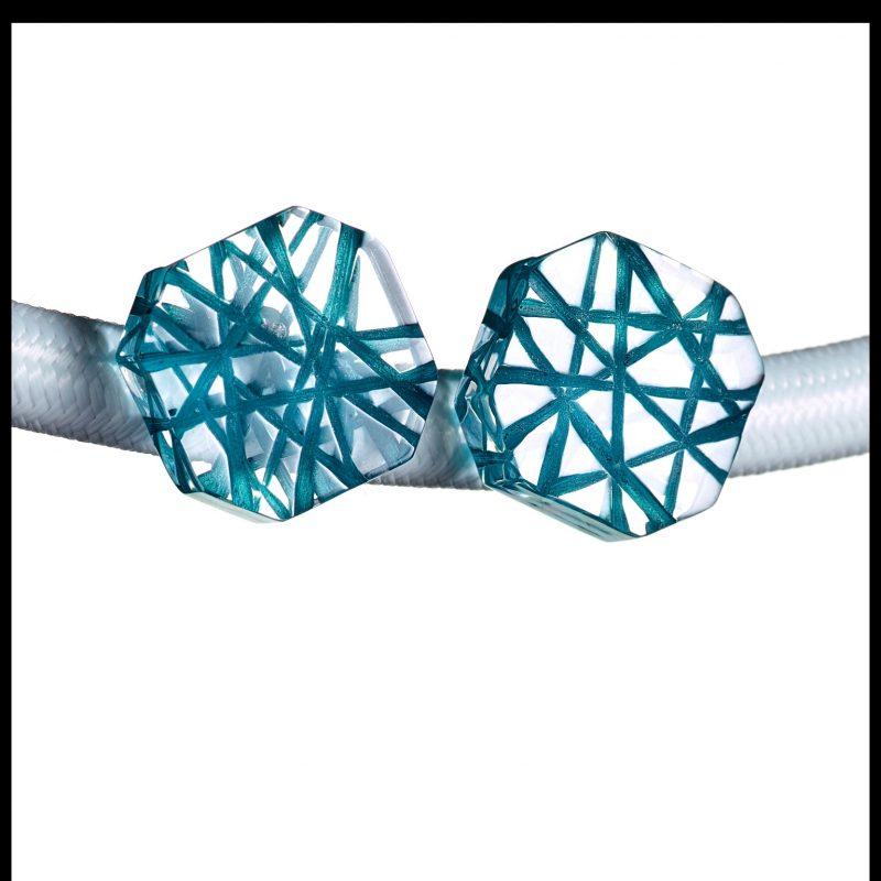 Acrylic  earrings with a Teal BlueCross hatch design