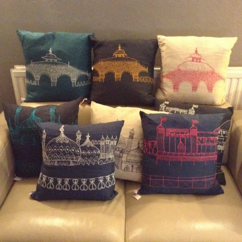 Five cushions that have been hand machine embroidered with 8mages of Brighton landmarks
