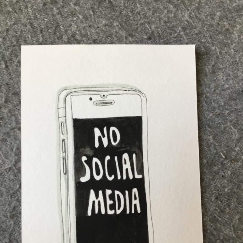 Postcard with a mobile phone with a black screen drawn in the middle of the image. The writing inside the screen reads 'No Social Media'