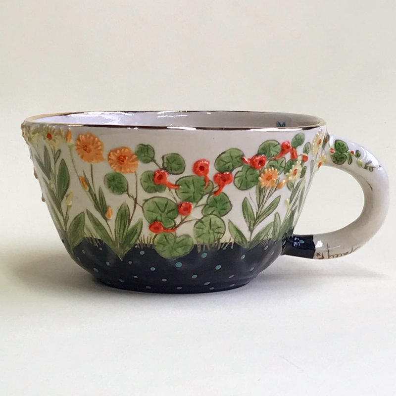 Handmade mug with vegetables and flowers  decoration