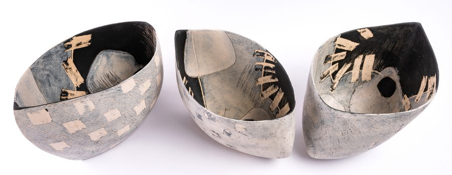 Monochrome sculptural ceramic vessels and one off relief prints