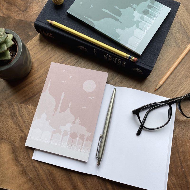 2 notebooks showing an illustration of Brighton's landmarks