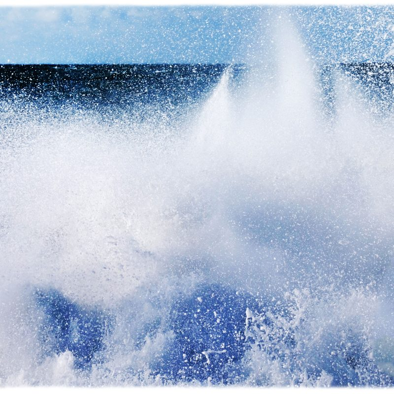 abstract photograph of a big wave breaking on the sea shore