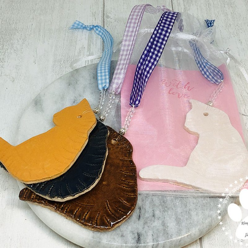 A selection of cat ornaments to choose from in different colours.