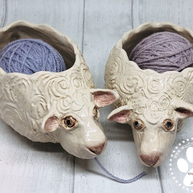 One pottery sculpture of a sheep with a space inside to store your yarn. The wool can then either come out at the front or back of the sheep.