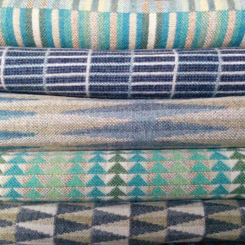 A stack of cool coloured throws.