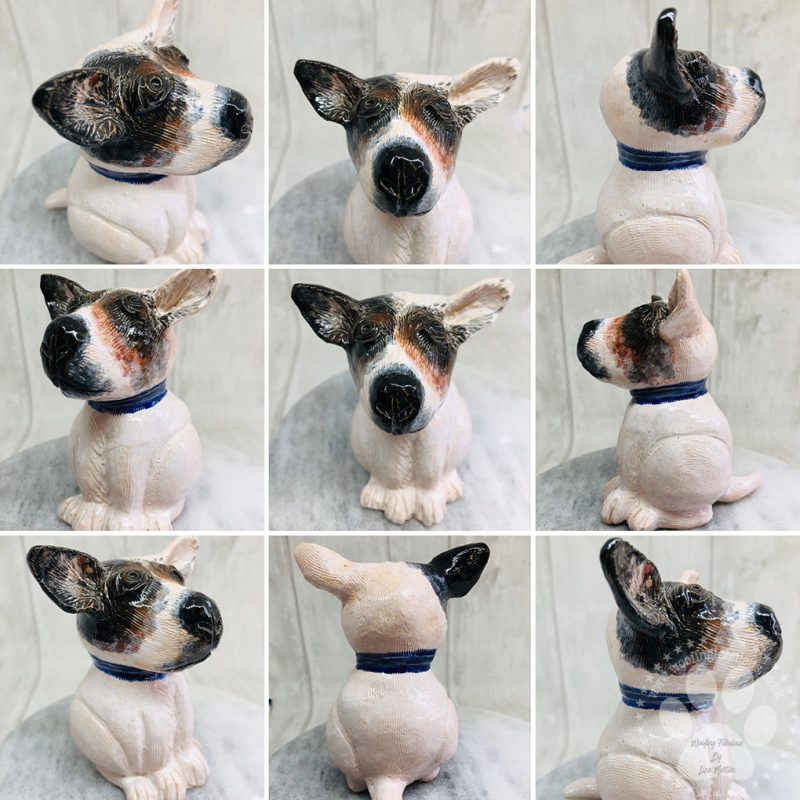 A little pottery sculpture of a Jack Russel Terrier called Marty with white, brown and black glazes.