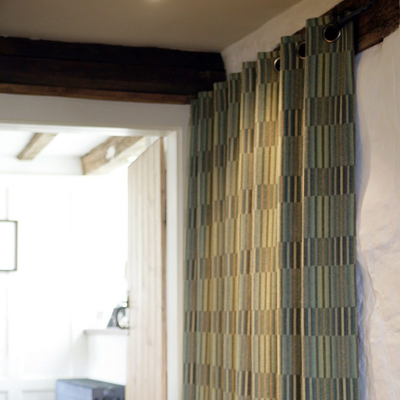 Curtains in Reeds Jade fabric in customer's house. These are made to order.