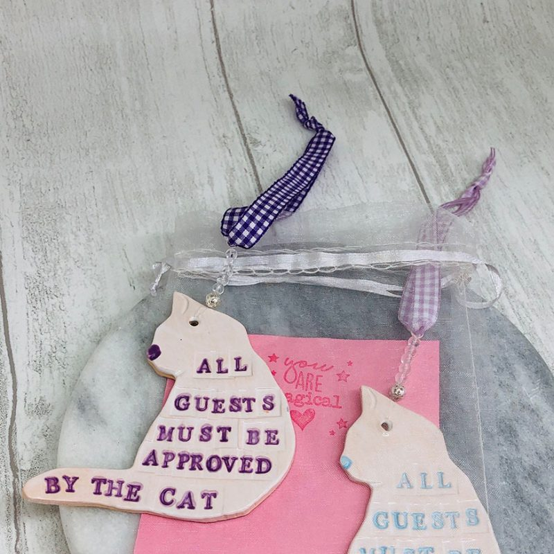 Cat Ornaments with quotes and sayings on. This one says