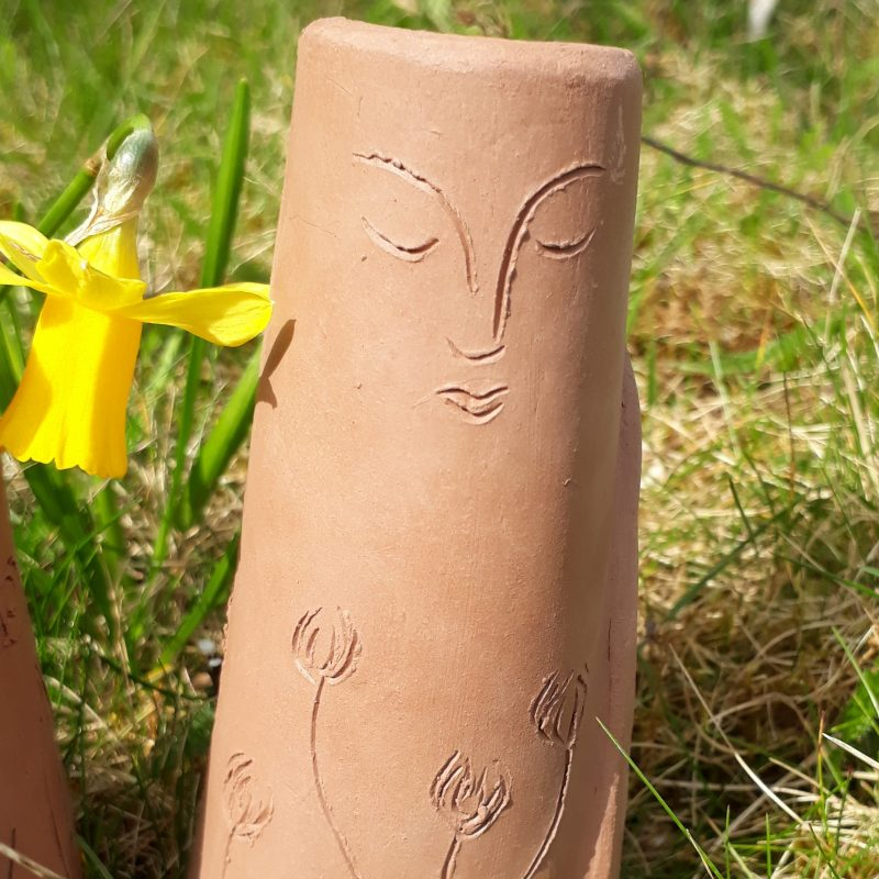 The earthy consistency and texture of clay appeal to me, it's malleable yet resistant properties ground me. The process of building a pot, coil by coil or gradually expanding a pinch pot in my hands, the intuitive feeling for the right thickness and sensing of evenness; the rhythmical, magical forming of the curves and lines of a pot's walls and the mental sensation of relaxation yet clarity of focus while making with clay is uniquely meditative for me.  I am interested in fairy tales and myths, seeking the origins of ideas about how the world was formed, rites of passage and journeys through darkness. I'm fascinated by ancient clay figures and their relation to these ideas about connection to nature, our place in the world and how we can find our way back to this precious relationship.  I often make figures with perforations for candle light to shine from within, this feels like bringing a little of the sacred to the everyday. I want my work to connect with others who love the natural world, the hand made and are drawn to the ancient yet immediate appeal of my clay creations.