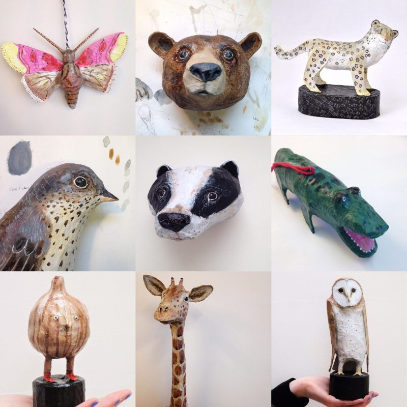 Various papier mache animal heads