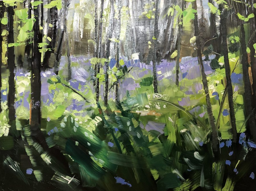 Inside a woodland, looking across at bluebells and fresh leaves growing on the tree. Oil painting with lots of texture.