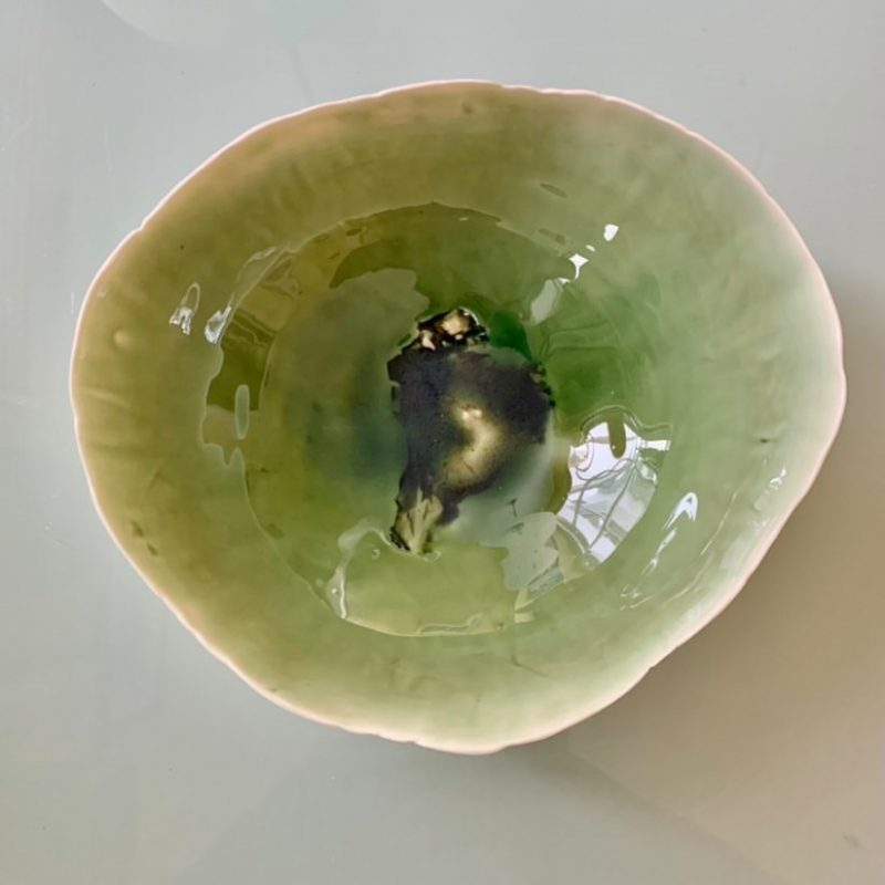 Colourful bowls and plates hand built using oyster shell from the beach for texture.